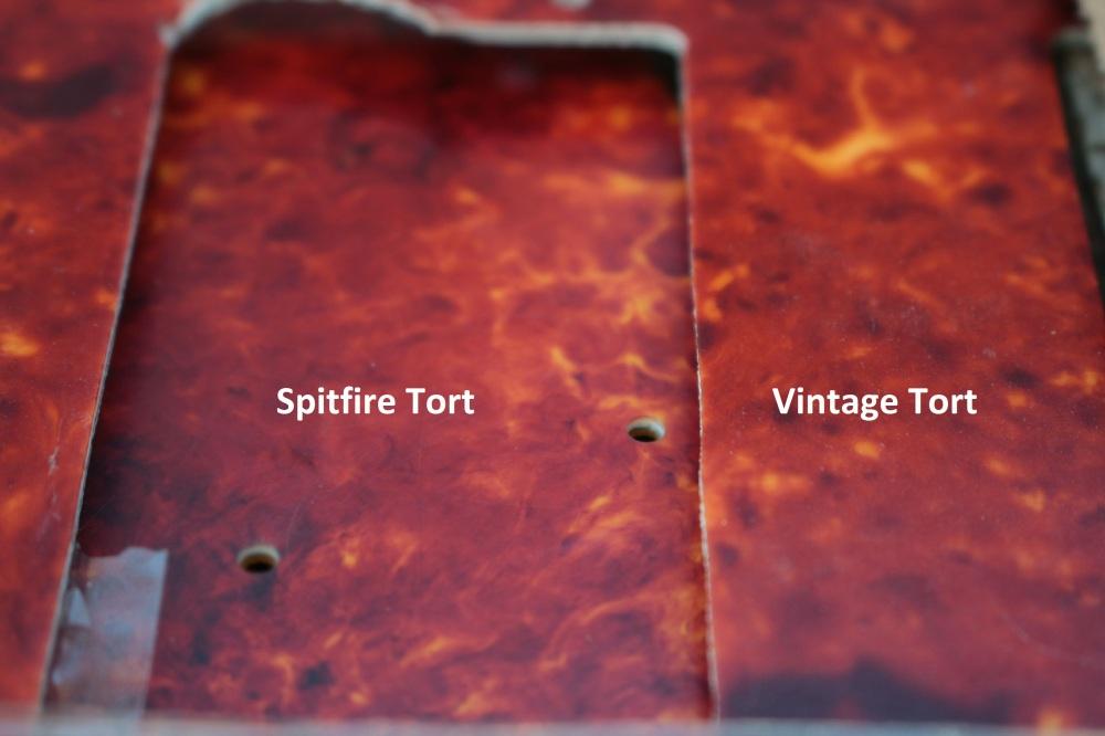 Vintage Original 60s tort on top of Spitfire Vintage Bright Red and relic tort.